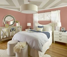 A large, tone-on-tone diamond pattern is easy to replicate using Benjamin Moore Rocky Road (CC-470) and Cedar Key (OC-16). In this romantic bedroom, the geometric pattern on the ceiling provides an artistic complement to the coral-coloured Dusty Mauve (2174-40) walls. Splashes of blue throughout create a cohesive look.