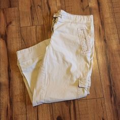 Loft pant or Capri These are great pants. They have 2 button heights to have full length, a low rolled cuff or a Capri length. Very well made with cargo pockets. It's between khaki and stone in color. LOFT Pants Ankle & Cropped