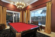 Grand Game Room traditional family room..love the ceiling color with the crown molding and wall color