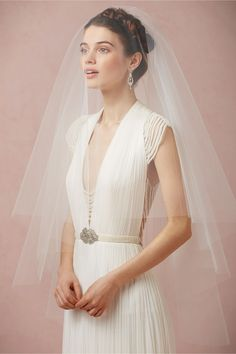 Cirque Veil in Bride Veils & Headpieces at BHLDN | Cut from a perfect circle of tulle, a center comb allows for this voluminous veil to be worn a number of ways; a softly rounded silhouette with no edges near the face and neck that allows your beauty to take center stage. From Paris by Debra Moreland.