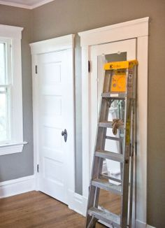 Behr Paint - Ashwood. I love the thick baseboards too!!