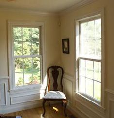 Colonial-style window. The simple painted crown molding and paneling with integrated chair rail is typical of the period.