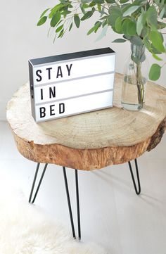 This DIY hairpin leg tree wood slice table makes a great home accent piece!
