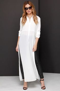 Throw the A For Effortless Ivory Maxi Top on over a cute pair of skinnies, and let the extra long panels steal the scene. A collared neckline introduces a button placket and long sleeves. Dress Over Pants, Shirt Dress, Kurta Designs, Blouse Designs, Mode Hijab, Long Blouse, Ao Dai, Mode Style, Long Tops