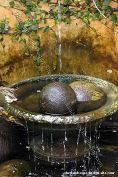 Something as simple as adding these balls to this stone bowl fountain helps to make it unique and more of a decorative piece of garden decor than just a plain pot or bowl