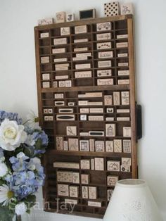 My old printers tray! Really an attractive solution for small stamps, if you have the wall space.