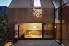 Gorgeous modern Kew House is clad in prefab weathering steel that create beautiful dappled light effects.