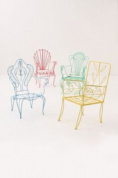Man Shops Globe Argentina-inspired chairs for Anthropolgie.  Each iron seat has been painted a vibrant hue drawn from the colorful La Boca port in Buenos Aires.