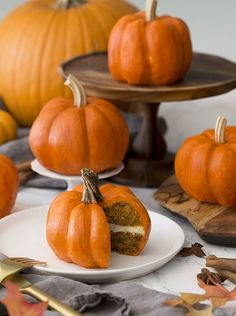 How to make mini pumpkin cakes on a table with real pumpkins mixed in. #preppykitchen #pumpkincake