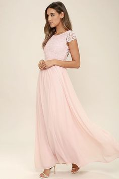 Celebrate your timeless beauty in The Greatest Blush Pink Lace Maxi Dress! Stunning floral lace overlays a princess seamed bodice with sheer cap sleeves and a backless design (with top button). A cascading, full maxi skirt flows from a fitted waist. Hidden back zipper/hook clasp.