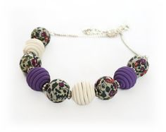 Bring a touch of boho style to your wardrobe with this purple bead necklace handmade with my Liberty of London fabric beads and teamed with my handmade polymer clay jewelry in complementing hues.