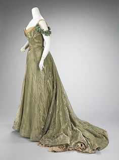 This ball gown (ca. 1898-1900 by Jacques Doucet) is simplistic in design, yet extravagant by the choice of materials used.  The sheer overlayer is enhanced by the solid lamé underlayers and a sense of luxury is added by the hidden lace flounce at the hem.  Undoubtedly, a woman would make an entrance in this dress, as it is extremely seductive with its form fitting silhouette and low décolleté.