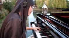 Yamaha's SH Silent Piano being put through its paces by HJ Lim on top of a canal boat in East London