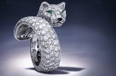 one of my favoritist Cartier Panthere pieces...emerald eyes, platinum and diamonds...ridiculous!