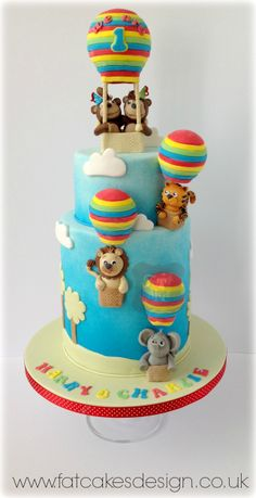 #rainbow #airballoons #twinscake #brightcolours #doublebarrelcake www.fatcakesdesign.co.uk