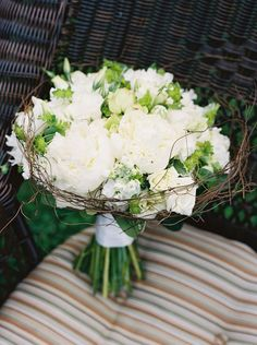 by engaging floral design  Well I always love the grape vine, curly willow or other vine surrounding a bouquet.
