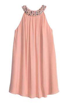 Vestido com contas bordadas