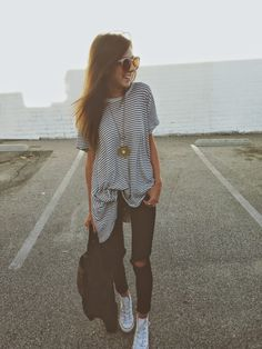 This outfit is perfect, cute stripes with converse and ripped pants