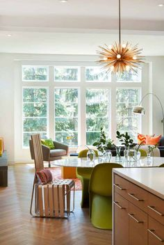 Repost via Photo by Spacecrafting Photography. This gorgeous light-filled space features Green Payton chairs by Vitra and a stunning grey Miller chair by Della Robbia! Skandinavisch Modern, Beautiful Modern Homes, Interior Photo, Modern Interior, Home Interior Design, Custom Home Builders, Custom Homes, Dining Room Design, Dining Area