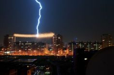 Lightning over cityscape