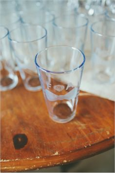 custom beer glass wedding favors #weddingfavors #weddingreception #weddingchicks http://www.weddingchicks.com/2014/02/13/yellow-and-white-wedding/