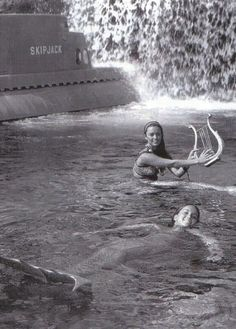 disneyland mermaids. yes, they used to have real women sitting in the lagoon posing as mermaids for the submarine voyage!