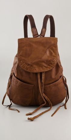A rich brown leather Alternative backpack with room for inorganic chemistry textbooks and files swiped from the admissions office for, er, University of New York student, Felicity Porter.