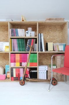 Wide shelving & colourful spines would look great in a studio (styling: Femke Pastijn, photo: Caroline Coehorst)