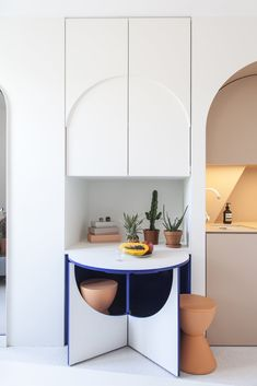 The tiny table with two stools pops out from the cabinetry. #smallspace #hometour #paris