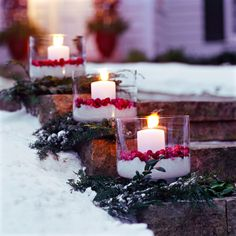 Cranberry Luminaries-Make the outside of your home as ready for the holiday season as the inside with these outdoor Christmas decorating ideas. Our holiday decorating ideas, including beautiful Christmas greenery, festive light displays, and Christmas Greenery, Decorating With Christmas Lights, Christmas Porch, Noel Christmas, All Things Christmas, Winter Christmas, Christmas Crafts, Holiday Decorating, Xmas