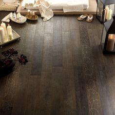 Ceramic tiles that look like wood flooring... would love this in a bathroom so the floor wouldnt warp. Ive seen this - love it! Would have it near fireplace, bathroom, mud room, kitchen laundry room for sure!