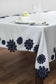 "Miss Julie Tablecloth Lovely and new from Juliana Hurtado, this sweet shop brings back older styles in a contemporary and beautifully made way. I chose the Miss Julie tablecloth, which is a 100% linen Italian tablecloth produced in a small, family owned mill in Tuscany. They ""added approximately 70 cotton, hand made dollies that add texture and weight, making this table cloth a statement on the table."""