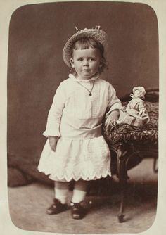 1860s Vintage picture of a little girl with her doll by photographer William Notman