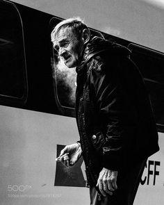 Man Smoking Next to Train Torino Italy by mcolvin1