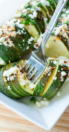 Hasselback-style sliced zucchini squash drizzled in evoo and topped with lemon, basil and creamy feta cheese. This speedy foil-baked side is sure to impress and SO easy to make!