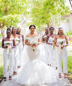 20 Wedding Parties That Prove Bridesmaids' Jumpsuits Are Just as Beautiful as Dresses women wearing white strapless bridesmaids jumpsuits holding white floral bouqets Chic Bridesmaid Dresses, Dessy Bridesmaid, Blue Bridesmaids, Wedding Bridesmaids, Wedding Attire, Wedding Gowns, Wedding Parties, Bridesmaid Jumpsuits, African Wedding Dress