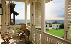 Above: Shutters surround a deck, offering unlimited views when open and privacy with a breeze when closed. Photograph via 30A.