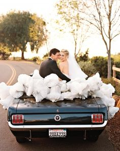 The newlyweds adorned a 1964 Ford Mustang with paper bells.