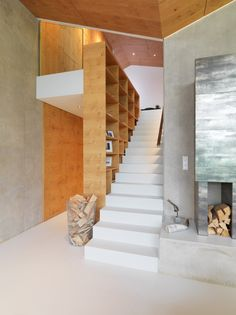 Mountain-View House / SoNo arhitekti, like the way the stairs don't have a handrail on the left, but substitute a book case-as-handrail.