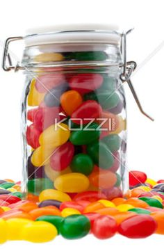 jelly bean jar - A jar of jelly beans surrounded by more jelly beans.
