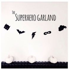 Superhero Garland SUPERHERO GARLAND A monochrome black and white garland by Velveteen Babies. With a Batman mask, bat, lightning bolt, bandit mask and cloud with white thunderbolt this would be a perfect addition to any little superheros bedroom. Measuring approximately 1 meter long, items are spaced out on clear line and all hand cut and sewn to the highest standard. 22 GBP