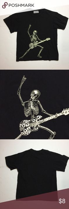 "Kids Skeleton Playing Guitar T-Shirt Tee Halloween Kids Skeleton Playing Guitar T-Shirt Tee Halloween. No Size or Material Tags. Please see measurements for fit. Measures flat: 15"" across shoulders, 16"" across chest, 17"" across bottom, 20"" long. 910/25/091317 Shirts & Tops Tees - Short Sleeve"