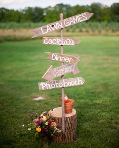 This fun wood sign directed guests to various wedding activities