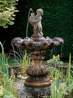 water fountain with a sculpture for luxurious backyard ideas