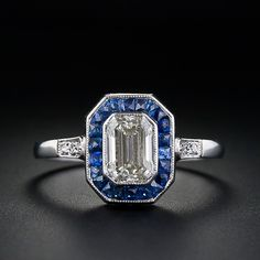 Gorgeous emerald cut surrounded by french cut sapphire halo. Simple, elegant.