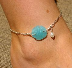 Fully adjustable, fits any ankle up to 10! Silver plated chain and 7/8 cultured sea glass milky blue sand dollar. Includes small white freshwater