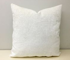 This Luxury hand made designer pillow cover in ivory.  Its made from high quality designer upholstery fabric.  Front and back is the same animal