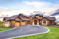 Rugged exterior of stone and wood on Architectural Designs Mountain Craftsman House Plan 54226HU. 3 beds and 3,900+ sq. ft. of living. Ready when you are. Where do YOU want to build?