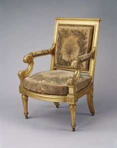 2 of 2: Morel & Seddon, Open armchair  1827-28, giltwood, with needlework covers. A set of six open armchairs, en suite with a sofa. Supplied to George IV for Windsor Castle as part of a suite of six armchairs and a sofa for Rooms 243 and 244. The needlework, from the Duke of York's collection, was sent to Morel & Seddon between 12 and 29 March 1827.