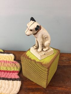 Nipper RCA Cast Iron Dog Bank, Jack Russel Terrier Dog Bank, Vintage Paperweight, Retro Doorstop, Dog Statue Figurine,  Cast Iron Bank by SoGlamorouslyVintage on Etsy https://www.etsy.com/listing/535357827/nipper-rca-cast-iron-dog-bank-jack
